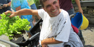 man with physical impairments participating in horticulture therapy