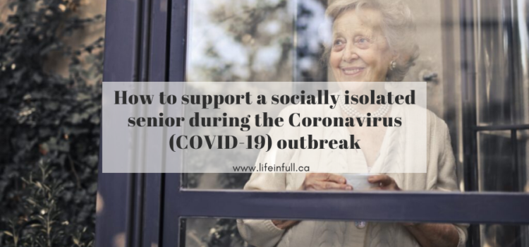 socially isolated senior looking out the window with a cup of tea during COVID-19 outbreak