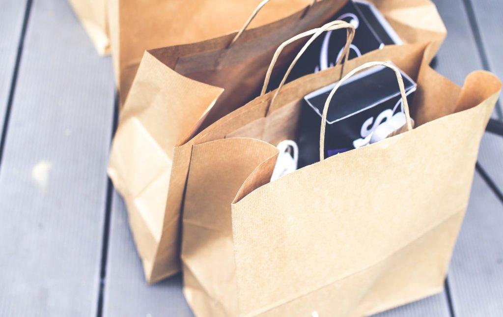 Brown paper bag care packages left on a doorstep
